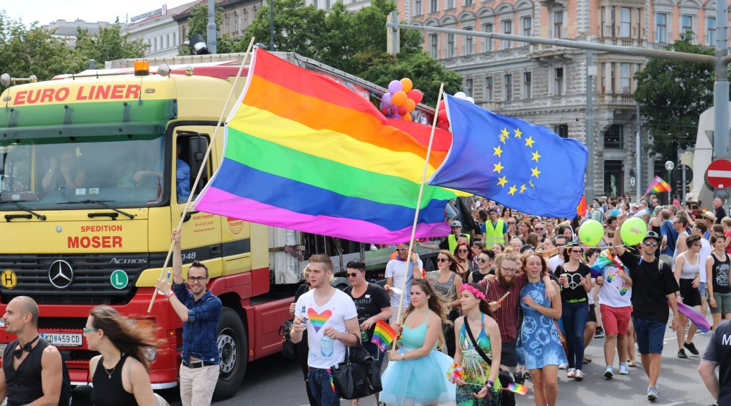 rainbow flag and EU flag at pride parade
