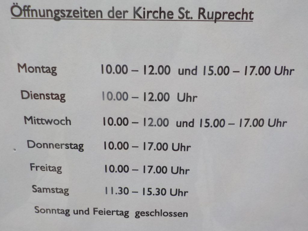 This photo shows a church's opening hours. It is open Monday through Saturday but closed Sundays and holidays.