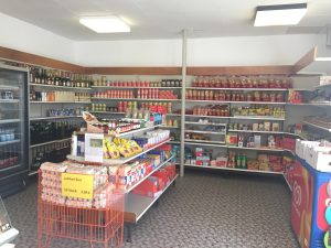 photo of a convenience store selling beverages and ice cream
