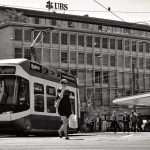 Photo of woman in front of a street car